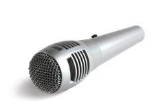 Microphone gris sur le blanc photographie stock