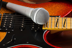 Microphone  on a  guitar background. Music art concept. Royalty Free Stock Photos