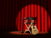 Microphone and Guitar on stage with Curtain Royalty Free Stock Photos