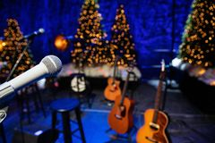 Microphone and guitars on stage during Christmas Holiday show stock photos