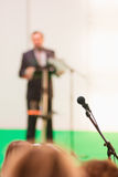 Microphone in the hall and out of focus protruding. Stock Images