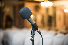 The microphone in the hall. To design presentations in lectures, seminars, festivals Royalty Free Stock Images