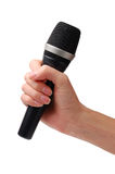 Microphone in hand. On a white background Stock Images