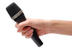 Microphone in hand. On a white background Stock Image