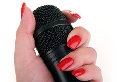Microphone in hand. Stock Photo