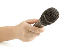 Microphone in hand Royalty Free Stock Images