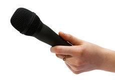 Microphone in hand. A woman holding a mic. Isolated Stock Photo
