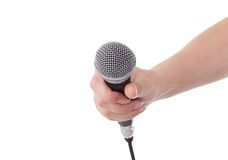 Microphone in hand. Isolated on white Royalty Free Stock Photos