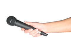 Microphone in hand Royalty Free Stock Photo