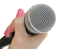 Microphone in a hand Royalty Free Stock Image