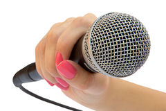 Microphone in a hand Royalty Free Stock Images