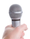Microphone in hand. Silver microphone in hand, isolated on white stock photography