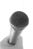 Microphone in the hand Royalty Free Stock Photos