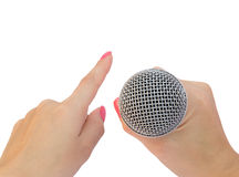 Microphone in a hand and hand as a pointer Royalty Free Stock Images