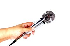 Microphone. Hand holding microphone isolated on white background royalty free stock images