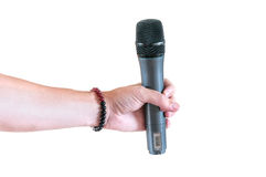 Microphone in hand Royalty Free Stock Photos