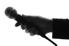 Microphone and hand silhouette Royalty Free Stock Image
