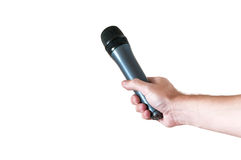 Microphone in hand Stock Photo
