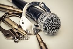 A microphone with handcuffs Royalty Free Stock Images