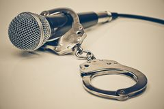 A microphone with handcuffs Royalty Free Stock Photos
