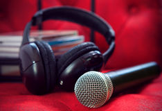 Microphone and head phone on red sofa leather use for entertainm Royalty Free Stock Photo