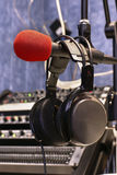 Microphone with head phones. In broadcasting station Stock Images
