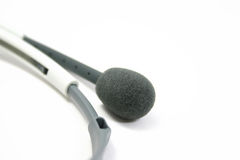 Microphone from the headphone set. On white Stock Images