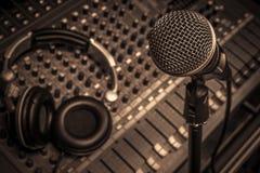 Microphone,headphone,sound mixer background. The microphone,headphone,sound mixer background royalty free stock image
