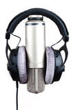 Microphone and headphones. On a white background close up royalty free stock photo
