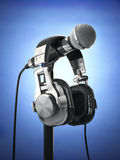 Microphone and headphones. Audio recording concept. Royalty Free Stock Images