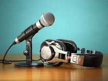 Microphone and headphones. Audio recording or radio commentator Stock Photography