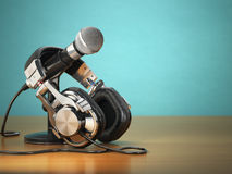 Microphone and headphones. Audio recording or radio commentator Stock Images