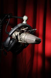 Microphone Headphones and Curtain Stock Photo