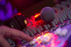 Microphone and Headphones on dirty sound mixer panel Stock Photo