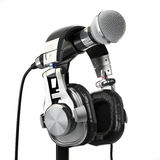 Microphone and headphones isolated on white. Audio recording con Stock Photography