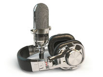 Microphone and headphones isolated on white. Audio recording or Royalty Free Stock Images