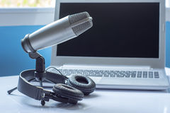 Microphone and headphones with laptop sound editing concept Royalty Free Stock Photo