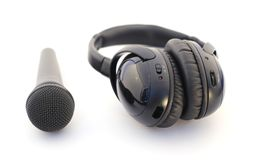 Microphone and headphones over white. Audio equipment: microphone and headphones over white Stock Image