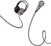 Microphone and headphones with wires. Stock Photos