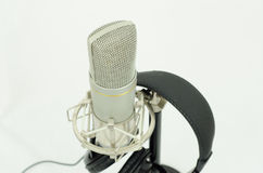 Microphone and headset. Silver microphone and black headset royalty free stock photos