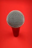 Microphone high angle close up over red Stock Images