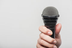 Microphone is hold by girl tv journalist Royalty Free Stock Photo