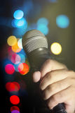 Microphone in human hand. Stock Photography
