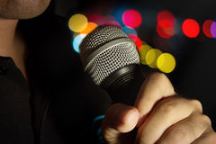 Microphone in human hand. Stock Photo