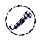 Microphone icon with halftone dots print texture. Stock Photography