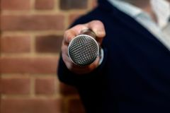 Microphone in the interviewer`s hand royalty free stock photos