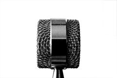 Microphone. Isolated microphone illustrating communication in business Stock Image