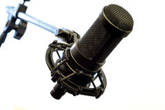 Microphone isolated. Professional condenser microphone on a stand isolated on white background Stock Photography