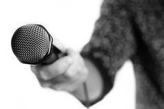 Microphone isolated in singing man hand Stock Image