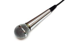 Microphone isolated on white. Photo of professional karaoke microphone. Isolated on white Royalty Free Stock Images